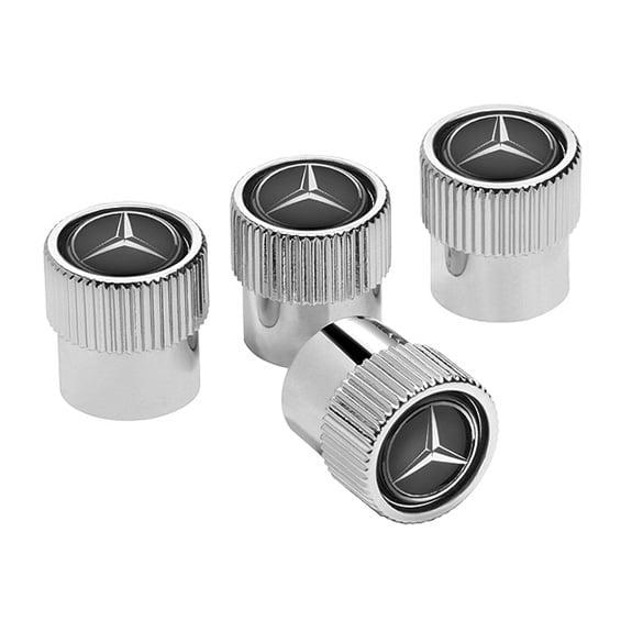 Valve caps set 4 pieces black genuine mercedes benz for Mercedes benz valve stem caps